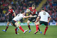 20121216 Copyright onEdition 2012©.Free for editorial use image, please credit: onEdition..David Strettle of Saracens faces up to David O'Callaghan (left) and Mike Sherry of Munster Rugby during the Heineken Cup Round 4 match between Saracens and Munster Rugby at Vicarage Road on Sunday 16th December 2012 (Photo by Rob Munro)..For press contacts contact: Sam Feasey at brandRapport on M: +44 (0)7717 757114 E: SFeasey@brand-rapport.com..If you require a higher resolution image or you have any other onEdition photographic enquiries, please contact onEdition on 0845 900 2 900 or email info@onEdition.com.This image is copyright onEdition 2012©..This image has been supplied by onEdition and must be credited onEdition. The author is asserting his full Moral rights in relation to the publication of this image. Rights for onward transmission of any image or file is not granted or implied. Changing or deleting Copyright information is illegal as specified in the Copyright, Design and Patents Act 1988. If you are in any way unsure of your right to publish this image please contact onEdition on 0845 900 2 900 or email info@onEdition.com