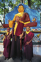 Tibetan Lama and his twin grandsons at Swayambunath, Kathmandu, Nepal.<br />