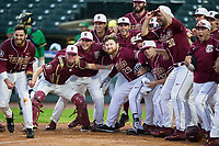 The Florida State Seminoles await the arrival of Jackson Lueck (not pictured) after his walk-off 2-run home run in the bottom of the 12th inning against the Notre Dame Fighting Irish in Game Four of the 2017 ACC Baseball Championship at Louisville Slugger Field on May 24, 2017 in Louisville, Kentucky.  The Seminoles defeated the Fighting Irish 5-3. (Brian Westerholt/Four Seam Images)