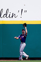 Andy Lasher (7) of the Evansville Purple Aces catches a fly ball to right field during a game against the Missouri State Bears at Hammons Field on May 12, 2012 in Springfield, Missouri. (David Welker/Four Seam Images)