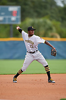 GCL Pirates third baseman Tilsaimy Melfor (12) throws to first base during a Gulf Coast League game against the GCL Rays on August 7, 2019 at Charlotte Sports Park in Port Charlotte, Florida.  GCL Rays defeated the GCL Pirates 5-3 in the second game of a doubleheader.  (Mike Janes/Four Seam Images)
