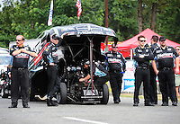 Aug. 5, 2011; Kent, WA, USA; NHRA funny car crew members for driver Matt Hagan during qualifying for the Northwest Nationals at Pacific Raceways. Mandatory Credit: Mark J. Rebilas-