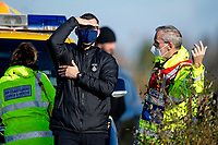 Pictured: A police man speaks with a coast guard as the search continues near Machynys, Llanelli, Wales, UK. Wednesday 04 November 2020  <br /> Re: Emergency services are searching for missing cockle picker Darren Rees, off the Carmarthenshire coast in Wales, UK.<br /> The 43 year old was last seen on Tuesday afternoon when he was cockling at low tide in the Machynys area of Llanelli.<br /> Dyfed-Powys Police, the coastguard and the national police helicopter are searching the coast and Loughor Estuary for Mr Rees.<br /> He was reported missing at about 18:40, but has not been seen since before it went dark.<br /> Police said he was last seen wearing green waders and a blue jumper, and have asked anyone who may have seen him to contact the force.