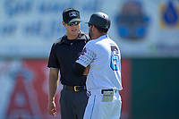 Inland Empire 66ers Manager Ryan Barba (6) discusses a call made by Base umpire Zach Neff at San Manuel Stadium on April 11, 2018 in San Bernardino, California. The 66ers defeated the Nuts 7-0. (Donn Parris/Four Seam Images)