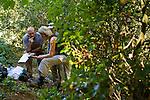 North American Cougar (Puma concolor couguar) biologists, Zachary Dautrich, Jen Joynt, and Ann Rockwell, checking camera traps, Tilden Regional Park, Berkeley, Bay Area, California
