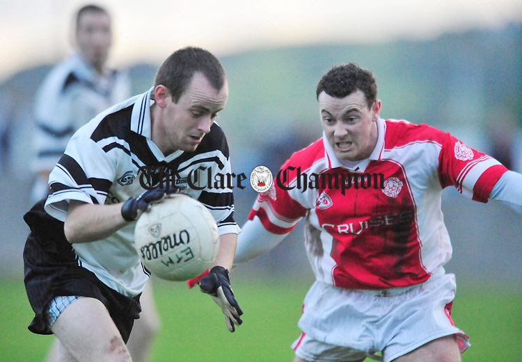 Enistymon's Wayne Griffin under pressure from Eire Og's - . Photograph by Declan Monaghan