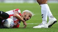 Brentford's Said Benrahma admires the boots of Charlton's Darren Pratley during Brentford vs Charlton Athletic, Sky Bet EFL Championship Football at Griffin Park on 7th July 2020