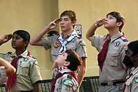 Boy Scouts from Troop 36 in Bentonville  watch Saturday Sept. 11 2021 the raising of the 9-11 Flag of  Honor during the 9-11 remembrance ceremony on the Bentonville square. Go to nwaonline.com/210912Daily to see more photos.<br />(NWA Democrat-Gazette/Flipi Putthoff)