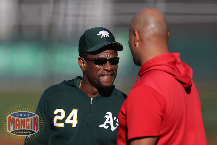 OAKLAND, CA - SEPTEMBER 4:  Coach Rickey Henderson #24 of the Oakland Athletics laughs during batting practice before the game against the Los Angeles Angels at the Oakland Coliseum on Wednesday, September 4, 2019 in Oakland, California. (Photo by Brad Mangin)