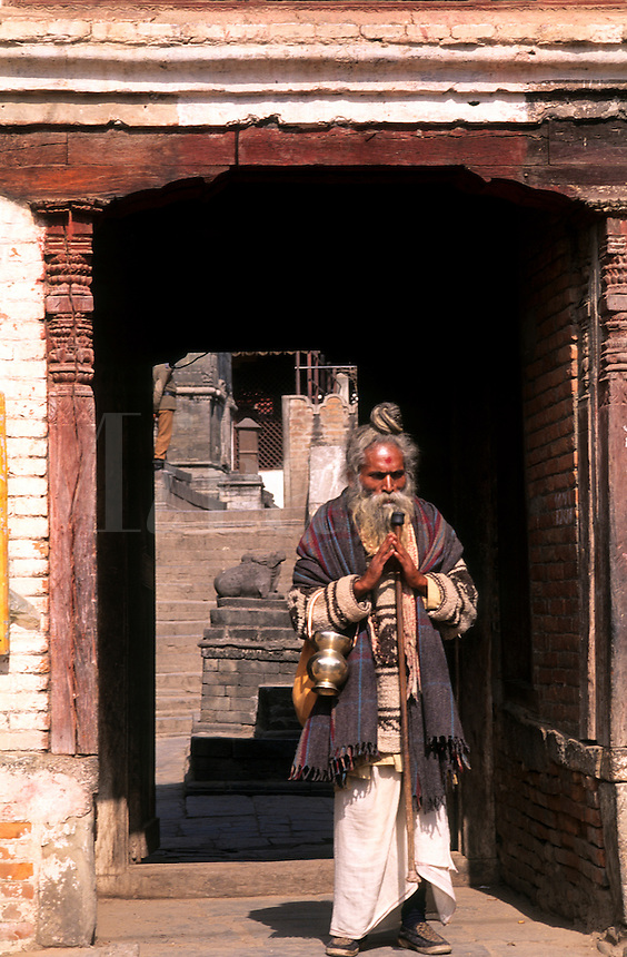 Religious man with wonderful character going into temple in Kathmandu Nepal Katmandu