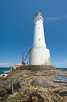 Great Basses Reef Lighthouse dwarfs the keeper offshore southwestern Sri Lanka.