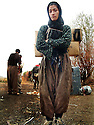 Iraq 2008.A Kurdish woman smugling goods to Iran near Penjwen.<br /> Irak 2008.Femme kurde faisant de la contrebande entre l'Irak et l'Iran dans la region de Penjwin