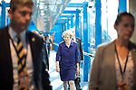 © Joel Goodman - 07973 332324 . 04/10/2016 . Birmingham , UK . THERESA MAY and Philip May cross the bridge from the hotel to the conference venue during the third day of the Conservative Party Conference at the International Convention Centre in Birmingham . Photo credit : Joel Goodman