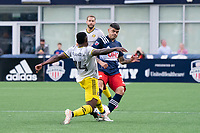 FOXBOROUGH, MA - MAY 16: Gustavo Bou #7 of New England Revolution passes the ball as Waylon Francis #14 Columbus SC pressures during a game between Columbus SC and New England Revolution at Gillette Stadium on May 16, 2021 in Foxborough, Massachusetts.