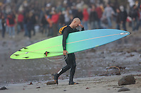 Shawn Rhodes leaves the water after the final heat of round one during the 2008 Mavericks Surf Contest in Half Moon Bay, Calif., Saturday, January 12, 2008...Photo by David Calvert/isiphotos.com