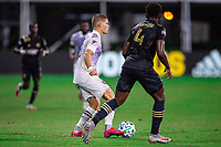LAKE BUENA VISTA, FL - JULY 20: Chris Mueller #9 of Orlando City SC dribbles the ball during a game between Orlando City SC and Philadelphia Union at Wide World of Sports on July 20, 2020 in Lake Buena Vista, Florida.