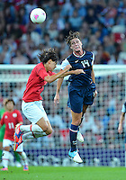 August 09, 2012: United States' Abby Wambach defends with a header against Japan's Saki Kumagai during Women's Football Final match at the Wembley Stadium on day thirteen in Wembley, England. USA defeat Japan 2-1 to win it's third consecutive Olympic gold medal in women's soccer.