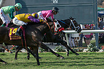 DEL MAR, CA  JULY 21:  #10 War Heroine, ridden by Tyler Baze, hangs on over a fast closing #14 Ollie's Candy, ridden by Corey Nakatani, to win the San Clemente Stakes (Grade ll) on July 21, 2018, at Del Mar Thoroughbred Club in Del Mar, CA