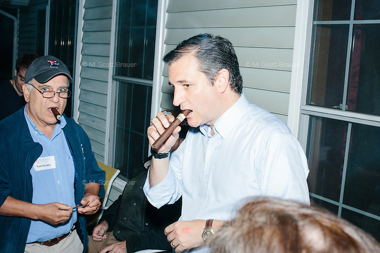 """Texas senator and Republican presidential candidate Ted Cruz smokes a cigar after speaking at an event called """"Smoke a cigar with Ted Cruz"""" at a house party at the home of Linda & Steven Goddu Salem, New Hampshire."""
