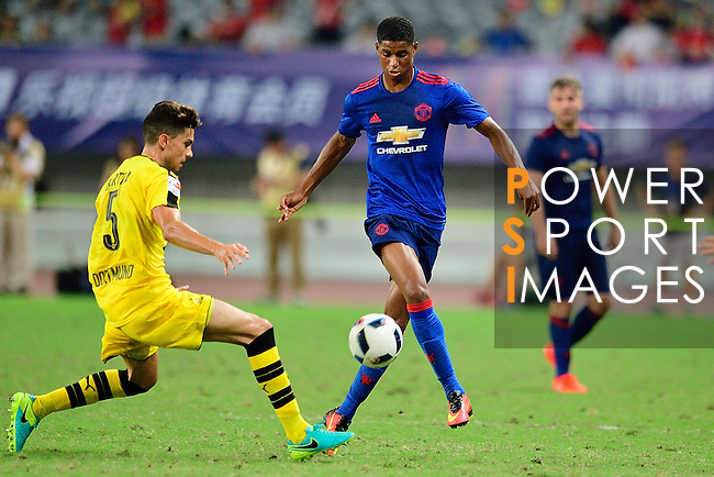 Manchester United forward Marcus Rashford (r) during the International Champions Cup China 2016, match between Manchester United vs Borussia  Dortmund on 22 July 2016 held at the Shanghai Stadium in Shanghai, China. Photo by Marcio Machado / Power Sport Images