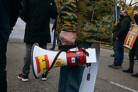 """MADRID, SPAIN - DECEMBER 07: Megaphone of one of the protesters decorated with Spanish flags and messages calling for the resignation of the government on December 7 in Madrid, Spain. With the slogan """"frente a su imposición, nuestra voz"""" several groups of fascist ideology against illegal immigration that is reaching the coasts of the Canary Islands, have demonstrated in the center of Madrid to ask the government to end the illegal immigration and that migrants arriving on the Spanish coasts are not accepted. (Photo by Joan Amengual / VIEWpress)"""