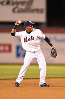 Binghamton Mets shortstop Wilfredo Tovar (2) warmup throw to first during a game against the Bowie Baysox on August 3, 2014 at NYSEG Stadium in Binghamton, New York.  Bowie defeated Binghamton 8-2.  (Mike Janes/Four Seam Images)