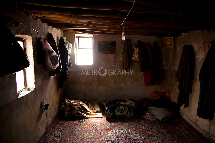 SHABADEEN, IRAQ: The interior of a smugglers den near the Iran-Iraq border...Thousands of Kurdish smugglers make a living ferrying goods between Iraq and Iran. They smuggle everything from clothes, to make-up, to alcohol which is forbidden in Iran. The smugglers make around 100,000 Iranian Rials ($8 USD) per journey and make 3 journeys per day...Photo by Aram Karim