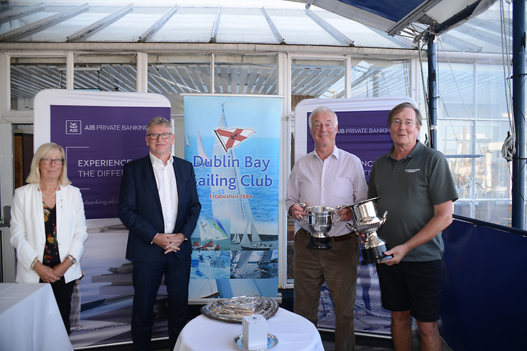 DBSC Commodore Ann Kirwan at the Royal St. George Yacht Club on July 16th 2021 pictured with DBSC Cruisers Two 2020 winners, Lindsay Casey and Denis Power with DBSC's Premier Trophy, The Waterhouse Shield. The RSTGYC J/97 crew also won the Lady Shamrock Trophy for Thursdays, the Silver Salver for Saturday IRC Racing and the TP Early trophy for Sat Echo racing. They are pictured with (second from left) DBSC sponsorJim Connolly of AIB