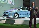 November 30, 2011, Tokyo, Japan - Akio Toyoda, president of Toyota Motor Corp. presents Prius PHV, a gasoline-electric hybrid vehicle, during a press preview of the Tokyo Motor Show on Wednesday, November 30, 2011...The Tokyo Motor Show opened to the press Wednesday as Japanese automakers unveiled a bevy of electric cars and other green vehicles at a much smaller venue in central Tokyo, to which the show moved from the nations largest exhibition hall in neighboring Chiba prefecture after 24 years. A total of 176 brands from 13 countries and regions participated in the show. The number of foreign automakers has increased to 24 from previous nine. Out of 398 models, 52 will be shown for the very first time. An estimated 800,000 visitors are expected to attend the week-long exhibition, compared with 1.5 million in 2005, according to the organizers.(Photo by Natsuki Sakai/AFLO) [3615] -mis-.