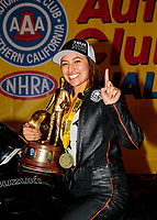Nov 17, 2019; Pomona, CA, USA; NHRA pro stock motorcycle rider Jianna Salinas celebrates after winning the Auto Club Finals at Auto Club Raceway at Pomona. Mandatory Credit: Mark J. Rebilas-USA TODAY Sports