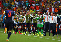 The Netherlands bench including manager Louis Van Gaal (right) celebrate their opening goal by Robin Van Persie (left)