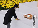 Japan's Prime Minister Shinzo Abe offer flowers during the memorial service for the war dead of World War II marking the 75th anniversary in Tokyo, Japan on August 15, 2020. (Photo by AFLO)