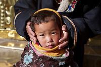 A Tibetan boy at Labrang (Chinese Name - Xiahe) Monastery on the Qinghai-Tibetan Plateau. China.