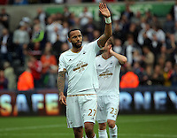 Pictured: Kyle Bartley of Swansea thanks home supporters after the end of the game Sunday 30 August 2015<br /> Re: Premier League, Swansea v Manchester United at the Liberty Stadium, Swansea, UK