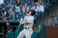 Elijah Dunham (14) of the Hudson Valley Renegades follows through on his swing against the Greensboro Grasshoppers at First National Bank Field on September 2, 2021 in Greensboro, North Carolina. (Brian Westerholt/Four Seam Images)