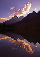 CLOUDS AND THE TETON MOUNTAIN RANGE ARE REFLECTED IN STRING LAKE DURING SUNSET AT GRAND TETON NATIONAL PARK,WYOMING