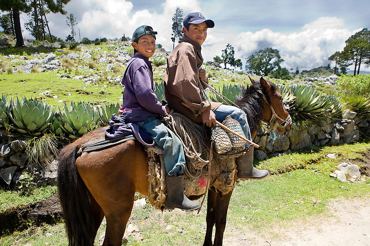 Two brothers mounted on a horse, near San Nicolas, Western Highlands, Guatemala