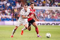Real Madrid's player Gareth Bale and Stade de Reims's player Rigonato during the XXXVII Santiago Bernabeu Trophy in Madrid. August 16, Spain. 2016. (ALTERPHOTOS/BorjaB.Hojas) /NORTEPHOTO