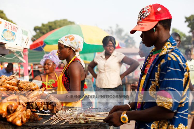 Vendors sell brochettes, chicken, and other food at the Salon International de l'Artisanat de Ouagadougou (Ouagadougou International Arts & Crafts Fair) in Burkina Faso.