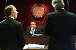 Gaming Control Board Chairman Mark Lipparelli, center, listens to Deputy Attorney General Michael Somps, left, and attorney Mark Clayton discuss online gaming during a meeting in Carson City, Nev., on Wednesday, Dec. 7, 2011. .Photo by Cathleen Allison