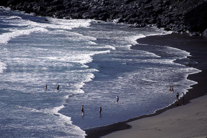People swimming in the ocean surf, Oregon