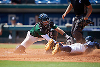 Jaime Ferrer (18) of TNXL Academy in Saint Cloud, FL attempts to tag Elijah Lambros (13) slides home during the Perfect Game National Showcase at Hoover Metropolitan Stadium on June 20, 2020 in Hoover, Alabama. (Mike Janes/Four Seam Images)