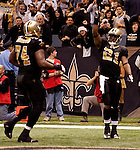December 2009: New Orleans Saints running back Mike Bell (21) celebrates after scoring a touchdown during an NFL football game at the Louisiana Superdome in New Orleans.  The Cowboys defeated the Saints 24-17.