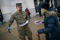 NEW YORK, NEW YORK - FEBRUARY 4:  National Guard members give information to people during COVID-19 vaccination hub at Yankee Stadium on February 5, 2021 in New York City. Yankees legend Mariano Rivera visit the Yankee Stadium on Friday as it was transformed into a COVID-19 vaccination mega-facility for resident of the zone. (Photo by Eduardo MunozAlvarez/VIEWpress)