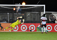 LAKE BUENA VISTA, FL - JULY 26: Tim Melia of Sporting KC watches the overtime penalty shot by Cristian Dájome of Vancouver Whitecaps FC hit the post during a game between Vancouver Whitecaps and Sporting Kansas City at ESPN Wide World of Sports on July 26, 2020 in Lake Buena Vista, Florida.