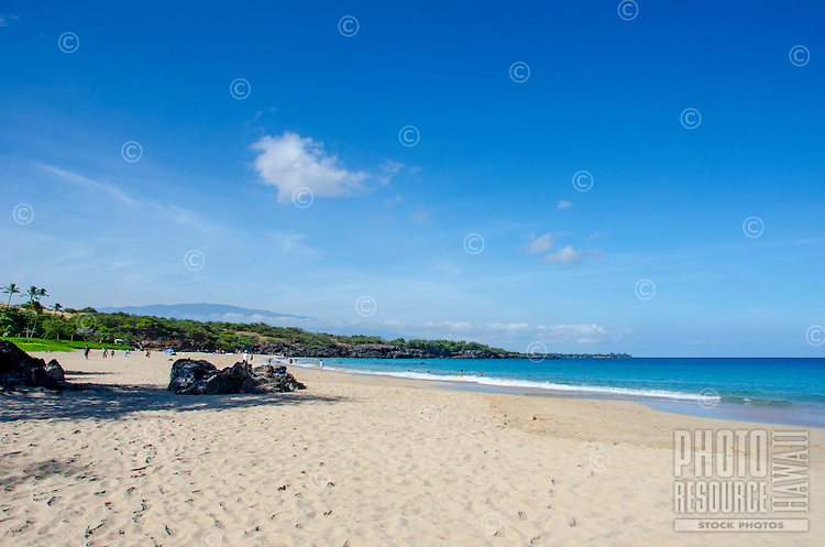 Hapuna Beach, along the Big Island of Hawai'i's Kohala Coast with Hualalai mountain in background. This white sand beach has been rated one of the best beaches in the world.