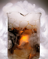 DRY ICE (SOLID CO2) SUBLIMATES & ACIDIFIES WATER<br /> CO2(s) Dropped In Water Forms Carbonic Acid<br /> Solid carbon dioxide dropped in water with bromthymol blue indicator forms carbonic acid which changes the indicator color to yellow. White smoke is a mist of water droplets condensed from the air by cold CO2 gas.
