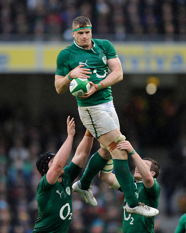 Jamie Heaslip of Ireland secures the lineout ball during the RBS 6 Nations match between Ireland and England at the Aviva Stadium, Dublin on Sunday 10 February 2013 (Photo by Rob Munro)