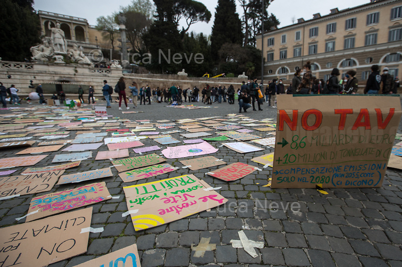 "Rome, Italy. 19th March, 2021. Today, Fridays for Future Rome (1.) - supported by various other Organizations and Movements - held a demonstration in Piazza del Popolo (2.) to mark the second anniversary of the Global Strike for Future demonstration (3.). The aim of the rally was to call the new Italian Government led by Professor Mario Draghi, and all the world Governments, to act for an immediate plan, investments and policies against the so called ""climate changes"" and the consequent climate crisis. The ""Fridays for Future"" actions are a series of global demonstrations directly related to Greta Thunberg (4.), the teenager ""Swedish political activist seeking to stop global warming and climate change, [who] in August 2018 became a prominent figure for starting the first school strike for climate, outside the Swedish parliament building"" (source Wikipedia.org, 5.).<br />
