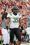 Oregon linebacker, Spencer Paysinger (#35), walks back to the huddle after a touchdown during the Ducks Pac-10 conference game against the Washington State Cougars at Martin Stadium in Pullman, Washington, on October 9, 2010.  In a game that went back and forth early in to the fourth quarter, Oregon finally prevailed over the Cougars, 43-23.